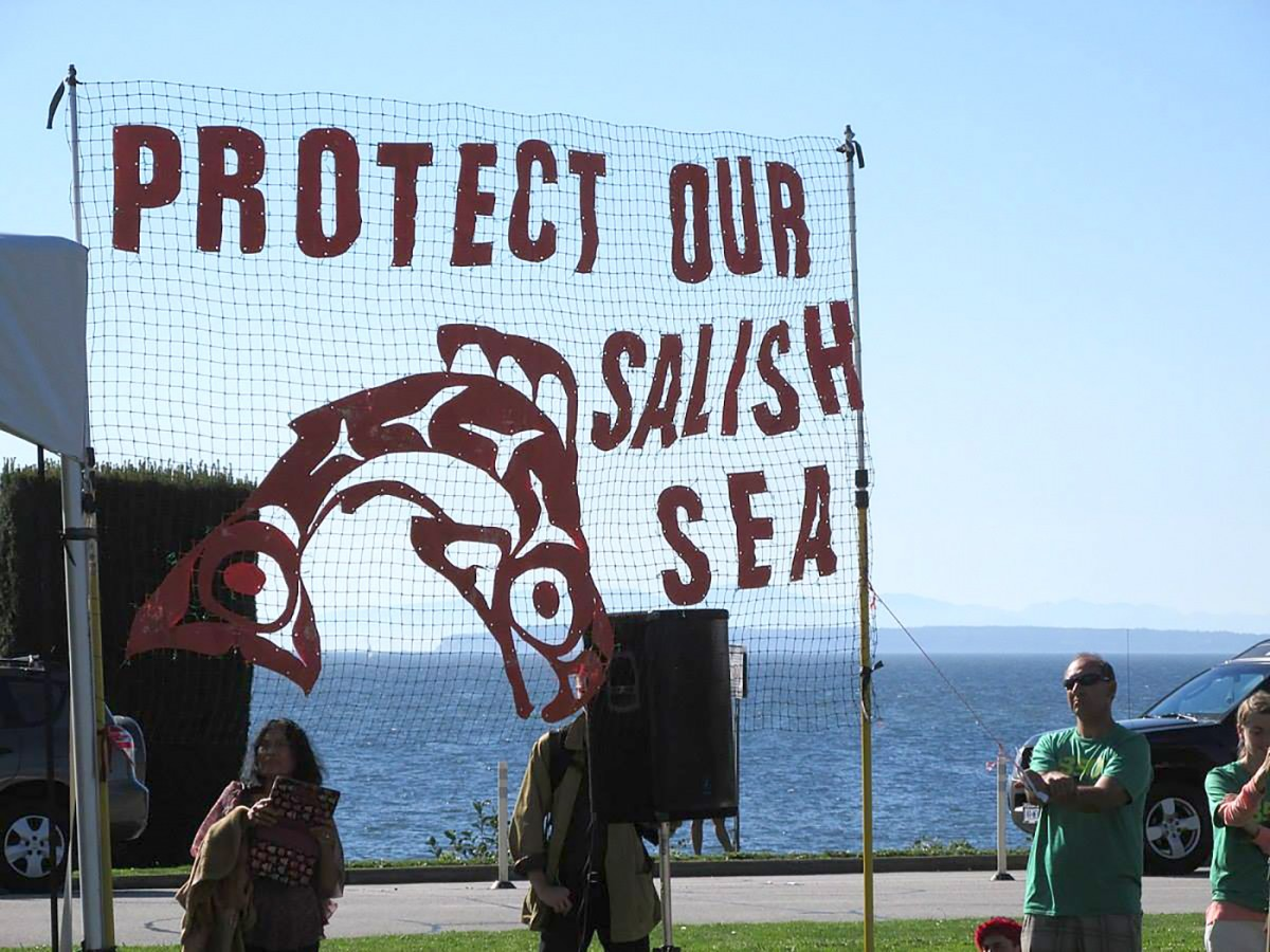 "A sign reading ""Protect Our Salish Sea"" at an anti-climate change rally held at Peace Arch Historical State Park on Sept. 22, 2014. (Photo: Robert Ashworth/Wikimedia)"