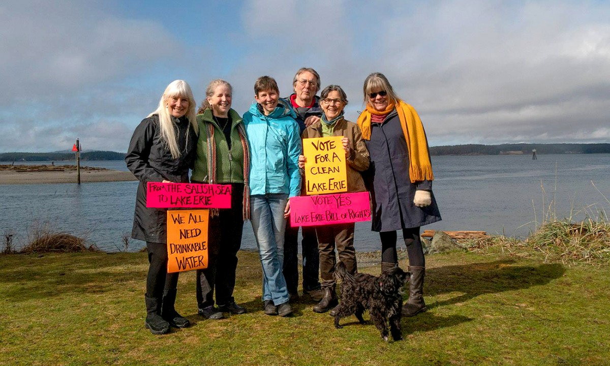 Members of Community Rights San Juan Islands hold up signs to show support for the Lake Erie Bill of Rights, which passed, in February 2019. (Photo: Ani Sandburn-Bill)