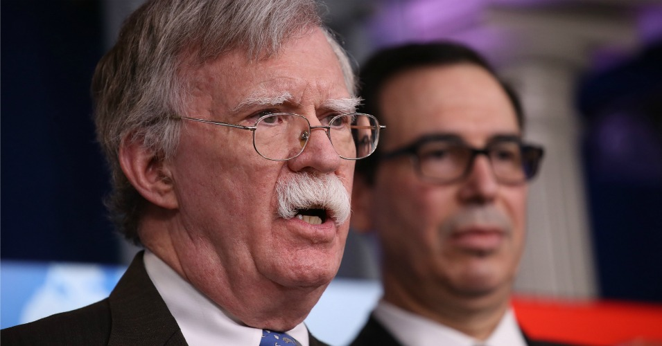 National Security Advisor John Bolton (L) and Treasury Secretary Steve Mnuchin (R) answer questions from reporters during a press briefing at the White House Jan. 28, 2019 in Washington, D.C. (Photo: Win McNamee/Getty Images)