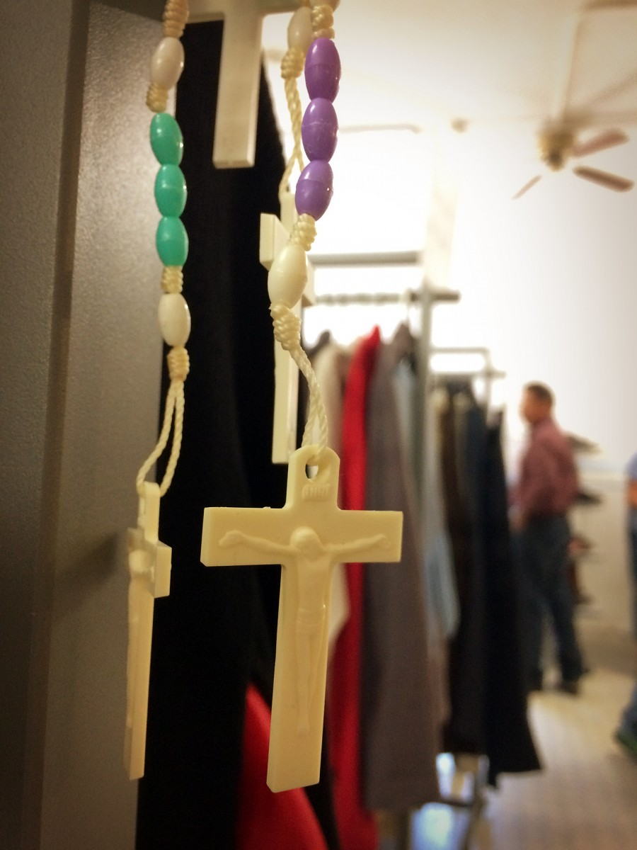 Rosaries are free for the taking in the clothing room, where asylum-seekers browse for well-fitting clothes. (Photo: Rose Lambert-Sluder)
