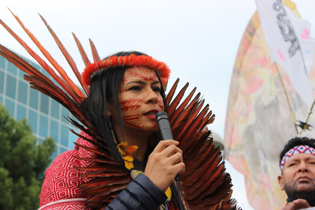 Daiara Tukano speaks at an action coordinated by Indigenous peoples of Brazil days after the killing of two Indigenous leaders in the Brazilian Amazon in December 2019. (Photo: Katherine Quaid/WECAN International)