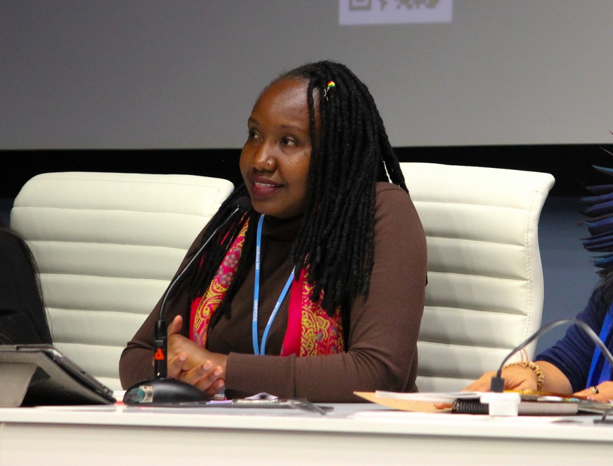 Ruth Nyambura discusses the intersection of gender, economy, and climate justice at a WECAN International U.N. side event at UNFCCC COP25 in Madrid, Spain. (Photo: Katherine Quaid/WECAN International)