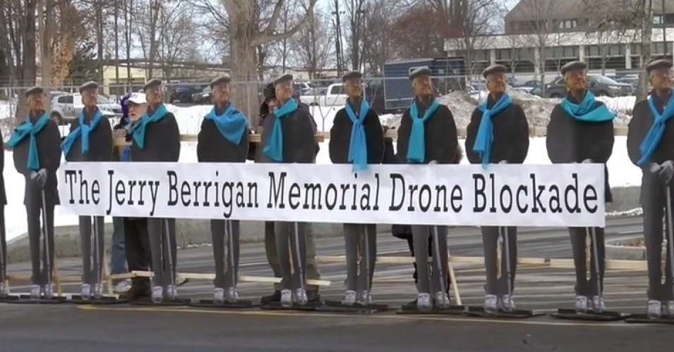 Life-size cut-outs of Jerry Berrigan arrayed to blockade at Hancock airbase in upstate New York on Jan. 28, 2016. (Screen grab from YouTube video)