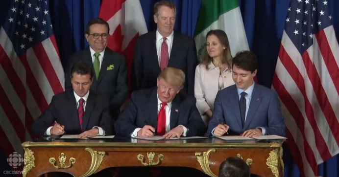 Mexican President Enrique Peña Nieto, U.S. President Donald Trump, and Canadian Prime Minister Justin Trudeau sign the new trade agreement to replace NAFTA on Friday, Nov. 30, 2018. (Screengrab via CBC News)