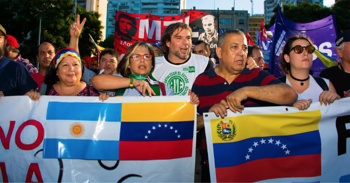 People hold posters during a demonstration by Venezuelans against foreign intervention under the slogan #VenezuelaQuierePaz (Venezuela Wants Peace) at United States Embassy on February 18, 2019 in Buenos Aires, Argentina. (Photo: Franco Fasuli/Getty Images)