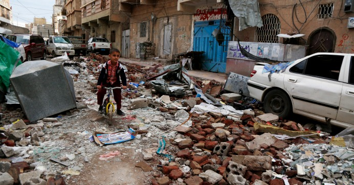 A Yemeni boy rides a bike on rubble of houses destroyed in a recent airstrike carried out by warplanes of the Saudi-led coalition, on May 23, 2019 in Sana'a, Yemen. (Photo: Mohammed Hamoud/Getty Images)