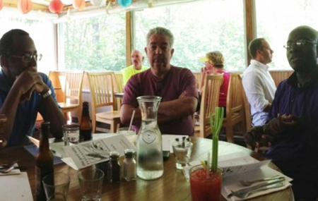 Ben Carson, (L); David D. Smith, president and CEO of Sinclair Broadcast Group, Inc.; and commentator Armstrong Williams at The Good Table restaurant near Smith's summer home in Cape Elizabeth, Maine (Courtesy of Armstrong Williams)