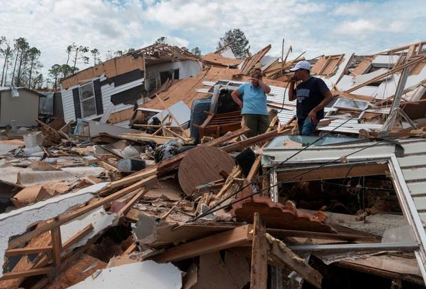 A couple react as they go through their destroyed mobile home following the passing of Hurricane Laura in Lake Charles, Louisiana, on August 27, 2020. (Photo: Andrew Caballero-Reynolds/ AFP via Getty Images)