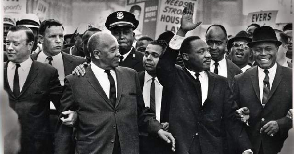 The Rev. Martin Luther King Jr. waves to onlookers while leading the 125,000 strong 'Walk to Freedom' on Woodward Avenue in Detroit in 1963. (Photo: Tony Spina / Detroit Free Press)