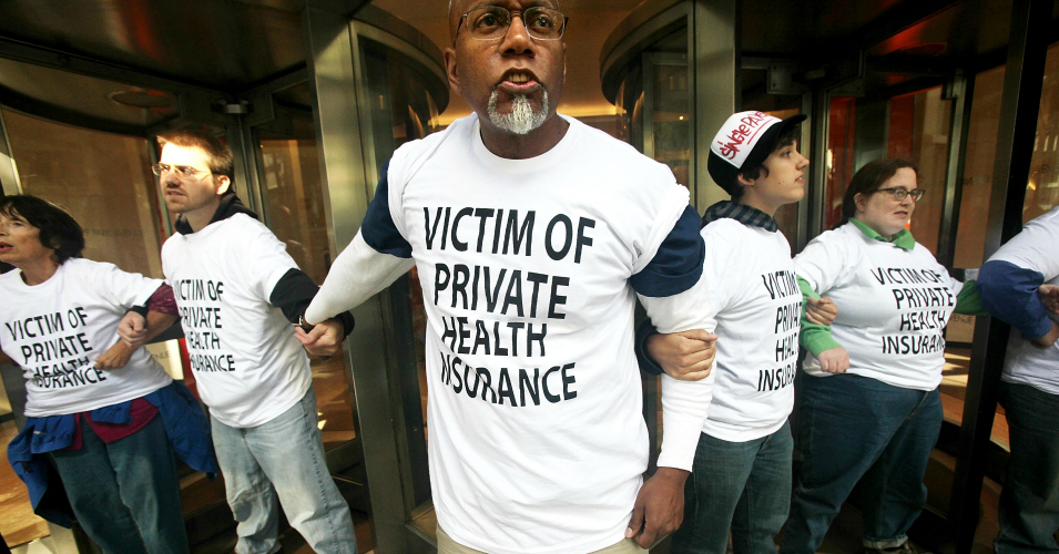 Health care reform supporters participate in a sit-in inside the lobby of a building where Aetna insurance offices are located September 29, 2009 in New York City. The protesters were eventually arrested by NYPD. (Photo: Mario Tama/Getty Images)