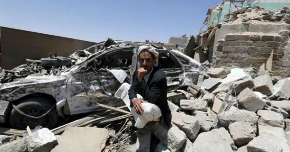 A Yemeni man sits beside his car and over the rubble of his house which was allegedly destroyed by an airstrike of the Saudi-led coalition targeting Houthi rebels' positions in Sanaía, Yemen, 29 March 2015. (Photo: EFE/EPA/YAHYA ARHAB)